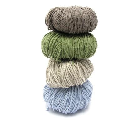 stapled: Four stapled balls of wool