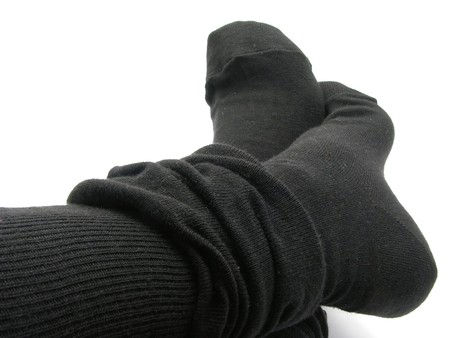Feet in black, plump and long stockings