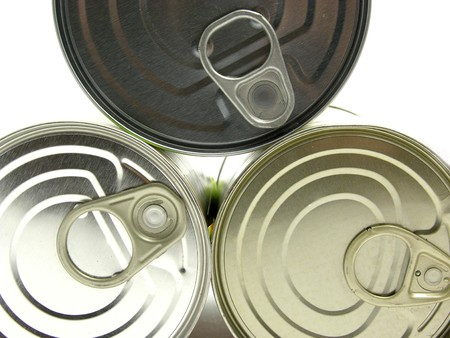 Three  lying tin cans on a white background photo
