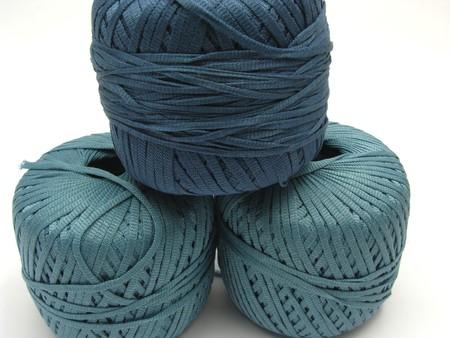 stapled: Three stapled  blue wool balls for needlework Stock Photo