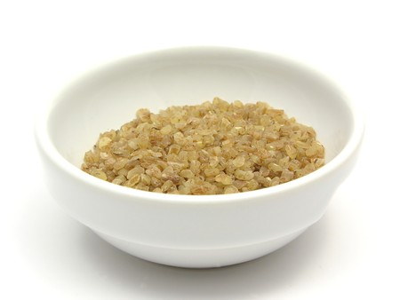 groats: A close-up view on bulgur wheat groats in a bowl of chinaware