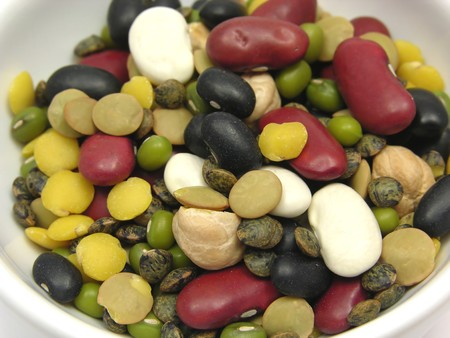 A close-up view on mixed and colourful legumes in a bowl of chinaware photo