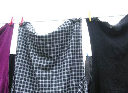 laundered: Clothesline  with some laundered clothes on white