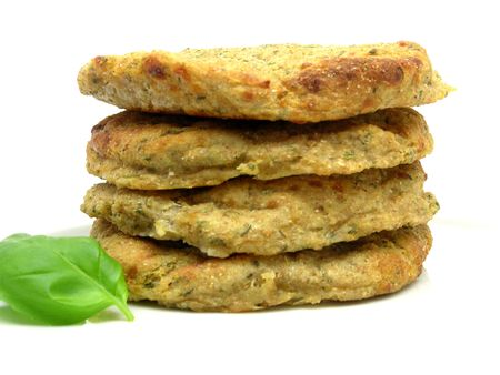 herbage: potato dough cakes with basil lying upon another