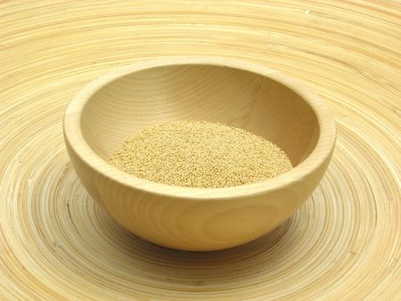 underlay: Wooden bowl with amaranth on bamboo plate