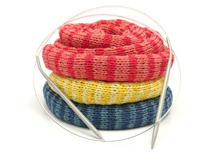 furl: Three striped reeled up knitting scarfs on white Stock Photo