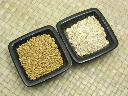 underlay: Bowls of chinaware with cereal and wholemeal on rattan underlay
