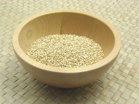 underlay: Wooden bowl with quinoa on rattan underlay