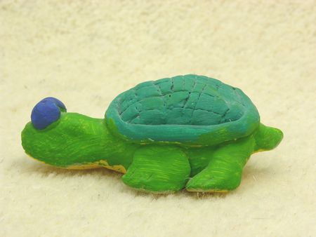 self made: Hand made ceramic turtle on soft background Stock Photo
