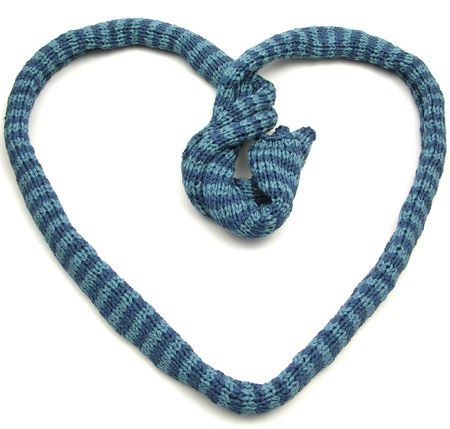 Blue striped knitting scarf arranged as heart on white photo