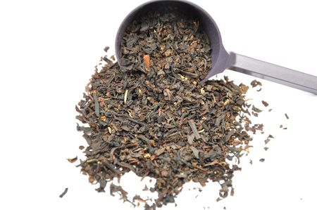 metering: Detailed but simple image of black tea mix with metering spoon Stock Photo