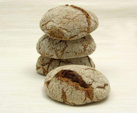 underlay: Home made wholemeal vinschgauer buns on beige underlay