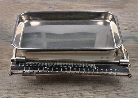 Old kitchen scales on wood photo