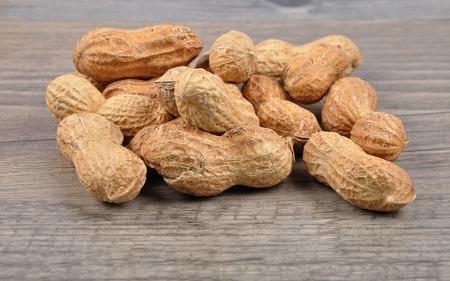 goober peas: Peanuts on wood
