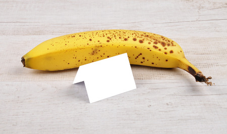 Banana and card Stock Photo