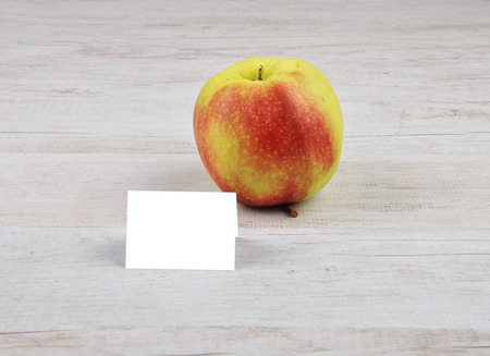 Apple and card Stock Photo
