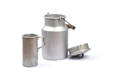 Graduated jug and milk can Stock Photo