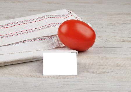 describable: Tomato and card