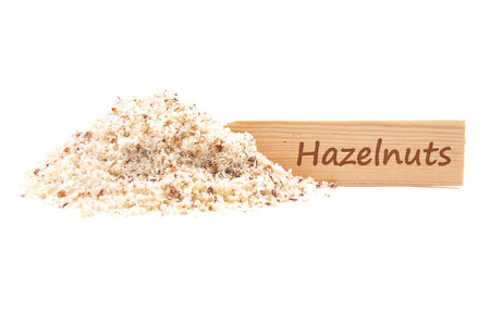 Hazelnuts powdered and plate Stock Photo