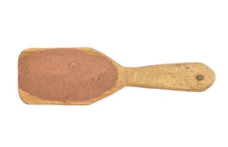 describable: Cocoa on shovel