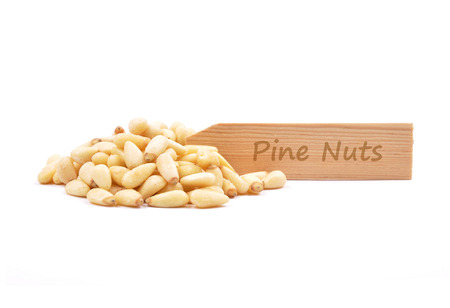 Pine nuts on white Stock Photo