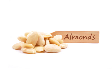 describable: Blanched almonds at plate Stock Photo