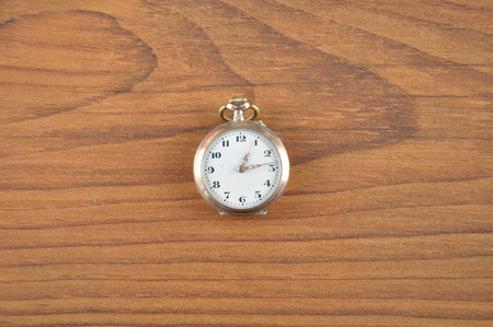 antiquated: Pocket watch on wood Stock Photo