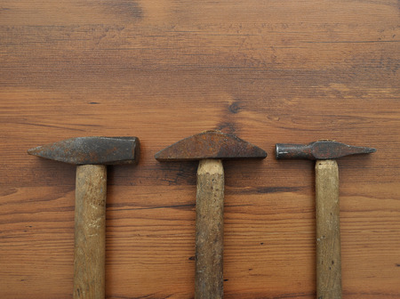 hammer nails in hardwood to bang with a hammer a nail in the knee stock photo picture and