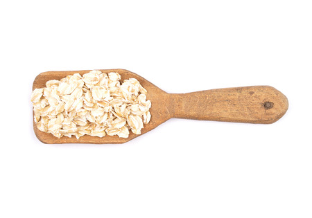 Oat flakes on shovel