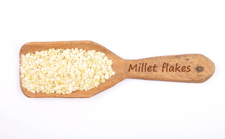 Millet flakes on shovel