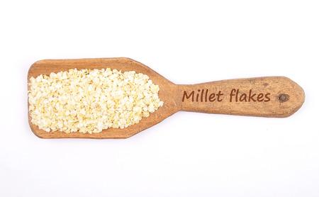 describable: Millet flakes on shovel