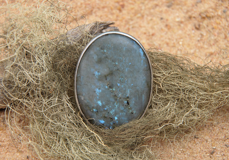 labradorite: Labradorite on beach