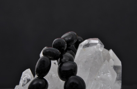 gemology: Obsidian on rock crystal
