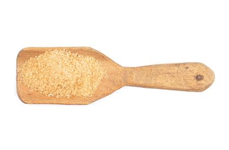 describable: Brown cane sugar on shovel