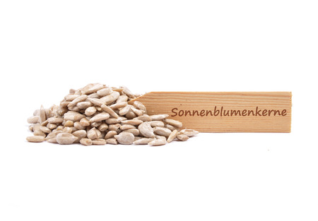 describable: Sunflower seeds at plate
