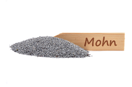 Poppy seeds on shovel Stock Photo