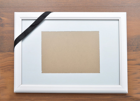 obituary: Picture frame with mourning band