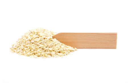 describable: Millet flakes at plate