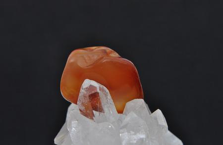 gemology: Carnelian on rock crystal Stock Photo
