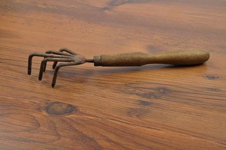 rake: Hand rake on wood