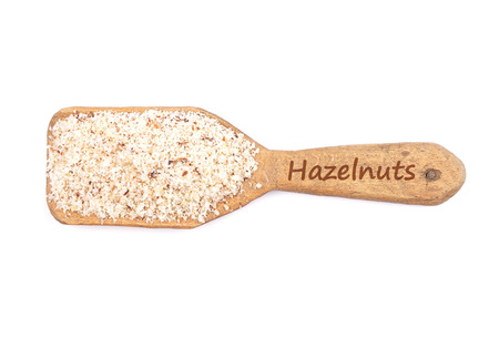 describable: Hazelnuts powdered on shovel