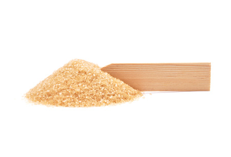 Brown cane sugar at plate Stock Photo