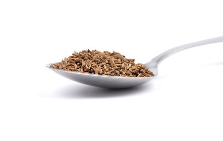 caraway: Caraway seeds on spoon Stock Photo