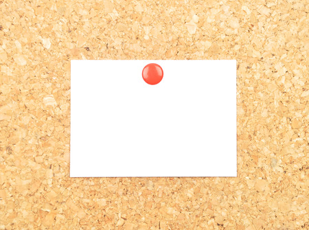 describable: Sheet of paper on cork