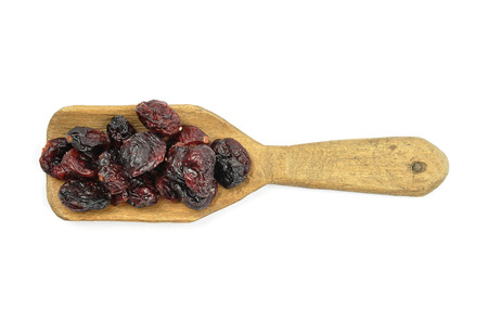 describable: Dried cranberries on shovel