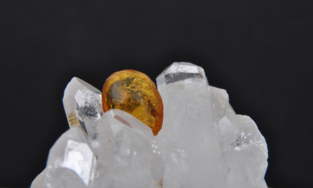 inclusions: Amber on rock crystal