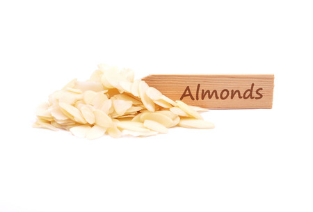describable: Almond slices on plate Stock Photo