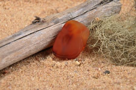 quarz: Carnelian on beach Stock Photo