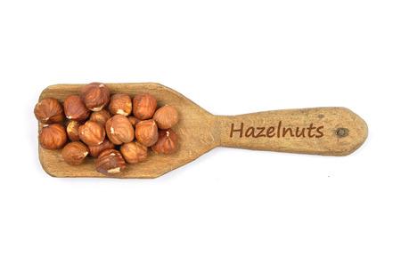 describable: Hazelnuts on shovel