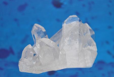 quarz: Rock crystal on blue Stock Photo